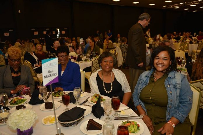 Working Women and Entrepreneurs - Women entrepreneurs gathered at a conference table for a luncheon