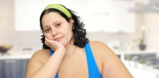 Still overweight: Curvy lady sitting at table with nothing to eat