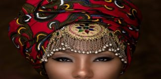 Being Black or African American woman head dress, jewels,