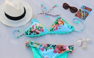 Swimsuit hacks - two piece with hat and glasses on white sand
