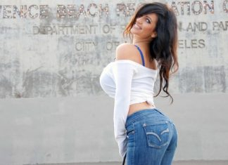 pretty woman with big breast and a big booty in jeans