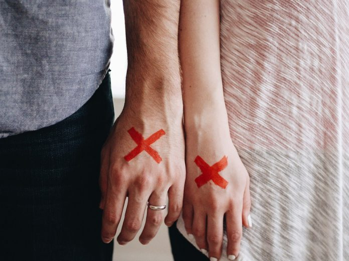 Dating the Wrong Woman Red X Marked X Couple Stamped Stigma Hands