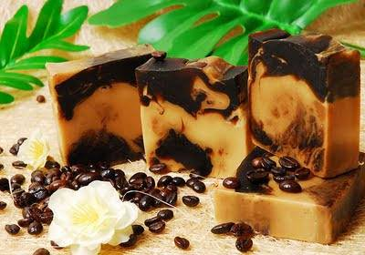 Coffee for skincare; Gold and brown bars of soap along side coffee beans