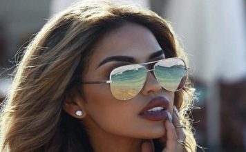 Successful People Have Common Traits; black woman wearing shades