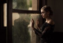 Getting Forgiveness in Relationships - woman standing at window