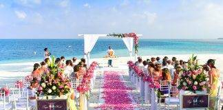 Breathtaking Tropical Wedding Destinations rose petals sandy beach people at wedding