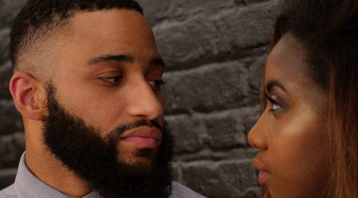 emotionally unavailable men - ebony man and woman staring in each other's eyes