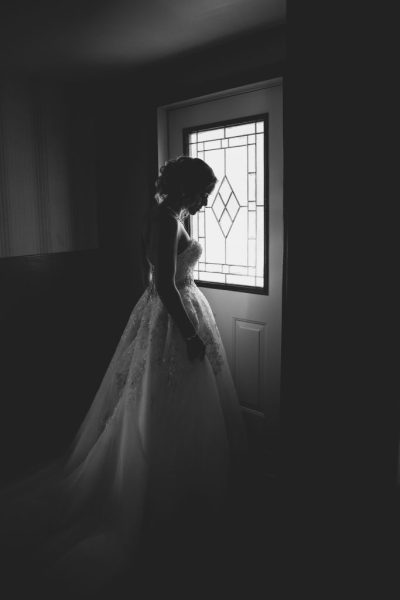 woman in wedding dress in the dark