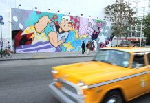 taxi service in Havana Tips To Select The Best Havana Transfer Service Long shot of colorful Popeye graffiti yellow taxicab