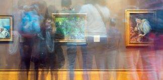 People blurred looking at artwork