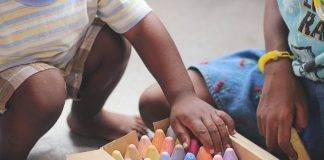 Ways to Motivate Kids to Learn, Play, and Love Life Kids picking out colored chalk
