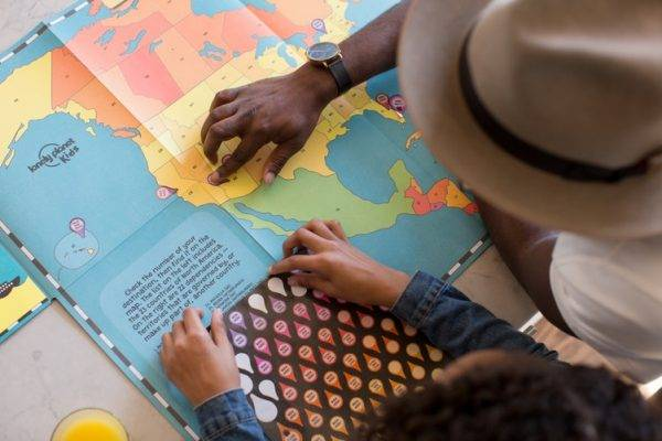 Ways to Motivate Kids to Learn, Play, and Love Life, children looking at map