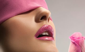 9 Ways to Get Rid of Dark or Black Lips Naturally woman wearing pink blindfold and pink lipstick