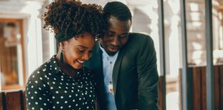 new relationship a young and stylish dark skinned couple standing in a sunny city 1157 14181