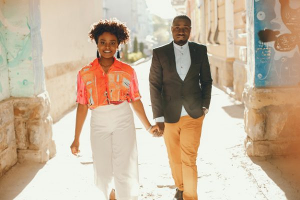 Find Out Which Zodiac Sign Will Make the Best Husband a-young-and-stylish-dark-skinned-couple-standing-in-a-sunny-city_1157-14188