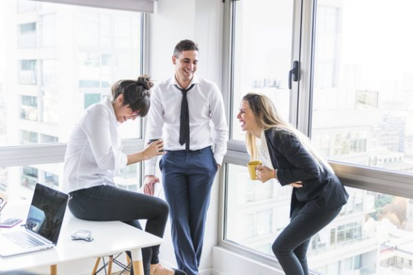 date co worker businessman looking two businesswoman laughing office 23 2147857267 600x400 - Should You Date Your Co-Worker? Not Before Reading These Tips
