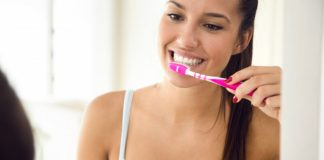 dental facts and tips pretty young woman brushing her teeth in the bathroom 1301 7648 324x160 - Home