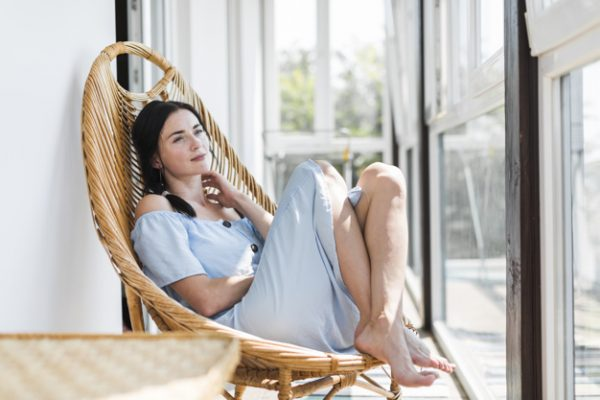 Top 11 Basic Self-Care Tips to Reduce Stress beautiful-young-woman-relaxing-on-wooden-chair-at-patio_23-2147923022
