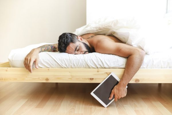 self care man sleeping on bed holding digital tablet 23 2147911954 600x400 - Top 11 Basic Self-Care Tips to Reduce Stress