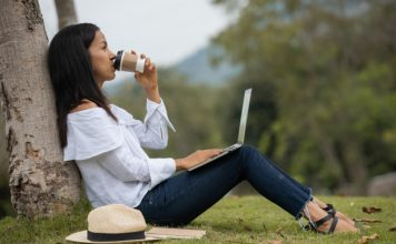 Top 11 Basic Self-Care Tips to Reduce Stress woman-working-on-a-laptop-in-the-nature_1150-6026