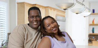 Couple in kitchen, portrait
