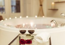 3 Exciting DIY Red Wine Bath and Body Scrub Ideas red wine bath flowers-glasses-drink-near-spa-tub-with-water-burning-candles-edges_23-2148003835