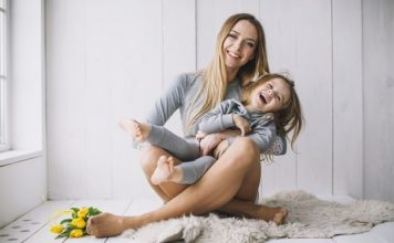 Relationships as a Single Mom: Are They Worth It? Mom holding her daughter playing on the floor