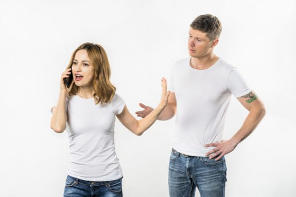 cheaters young-woman-talking-mobile-phone-showing-stop-gesture-her-boyfriend_23-2148056018