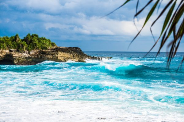 4 Off Beat Summer Vacation Ideas for Families waves on the ocean crashing on shore on indonesia 800