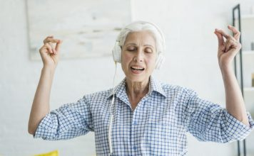 mothers day gifts senior woman listening music headphone snapping her fingers 23 2147918297