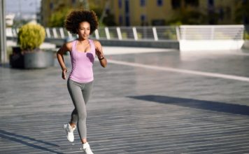 running for weight loss black woman afro hairstyle running outdoors urban road min