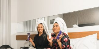 black women skin care two girls on bed with products photo by Creative Exchange