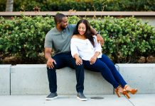 black love man with arm around girl