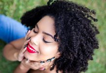 black woman natural hair sitting in grasss photo by Jorge Fakhouri Fillho pexels 2