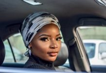Guarded woman pulls away black woman white black headscarf pexels photo Bashir Olawoyin