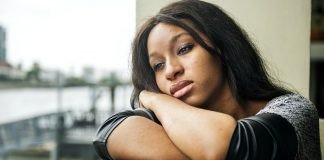 African american woman is sitting thoughtfully managing anxiety and depression