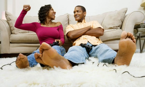 Stay-At-Home Date Ideas for Couples black couple playing video game